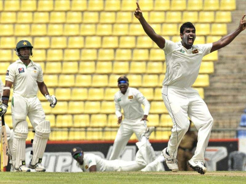 Sri Lankan bowler, Thisara Perera, successfully appeals for the wicket of Pakistan's batsman Taufeeq Umar during the first day of their third test cricket match in Pallekele, Sri Lanka. AP Photo