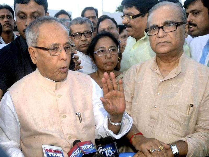 UPA Presidential candidate Pranab Mukherjee interacts with media on his arrival at NSCBI Airport in Kolkata. PTI Photo