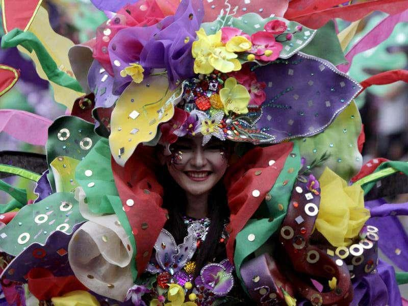 A woman dressed in costumes participate in the 11th Jember Fashion Carnival in Jember, Indonesia's East Java province. The carnival procession that had a 3.6 km ( 2.2 mile) route was made up of 700 participants, who wore creations made by fashion designers from 8 different Indonesian cities. REUTERS/Sigit Pamungkas