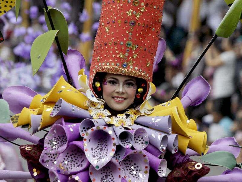 A woman dressed in flower costumes participate in the11th Jember Fashion Carnival in Jember, Indonesia's East Java province. The carnival procession that had a 3.6 km ( 2.2 mile) route was made up of 700 participants, who wore creations made by fashion designers from 8 different Indonesian cities.. REUTERS/Sigit Pamungkas
