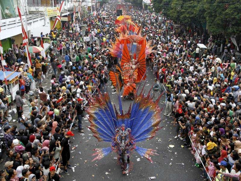 People dressed in costume participate in the 11th Jember Fashion Carnival in Jember, Indonesia's East Java province. The carnival procession that had a 3.6 km ( 2.2 mile) route was made up of 700 participants, who wore creations made by fashion designers from 8 different Indonesian cities. REUTERS/Sigit Pamungkas
