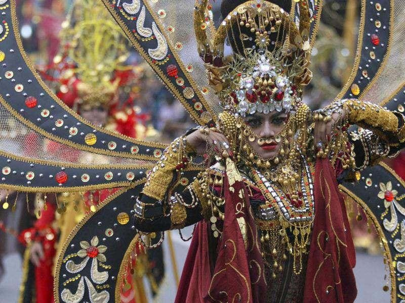 A model performs during Jember Fashion Carnival, an annual event to showcase creations by local fashion designers, in Jember, East Java, Indonesia. (AP Photo/Trisnadi)