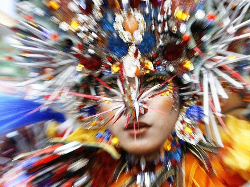 A woman dressed in costume participates in the 11th Jember Fashion Carnival in Jember, Indonesia's East Java province. The carnival procession that had a 3.6 km ( 2.2 mile) route was made up of 700 participants, who wore creations made by fashion designers from 8 different Indonesian cities. REUTERS/Sigit Pamungkas