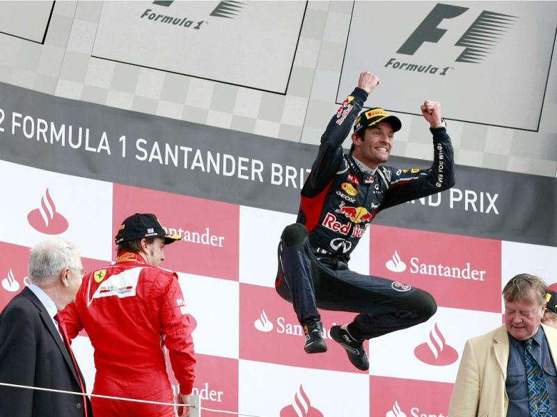 Australia's Mark Webber celebrates after winning the Formula One British Grand Prix at the Silverstone circuit, Silverstone. AP/Tim Hales