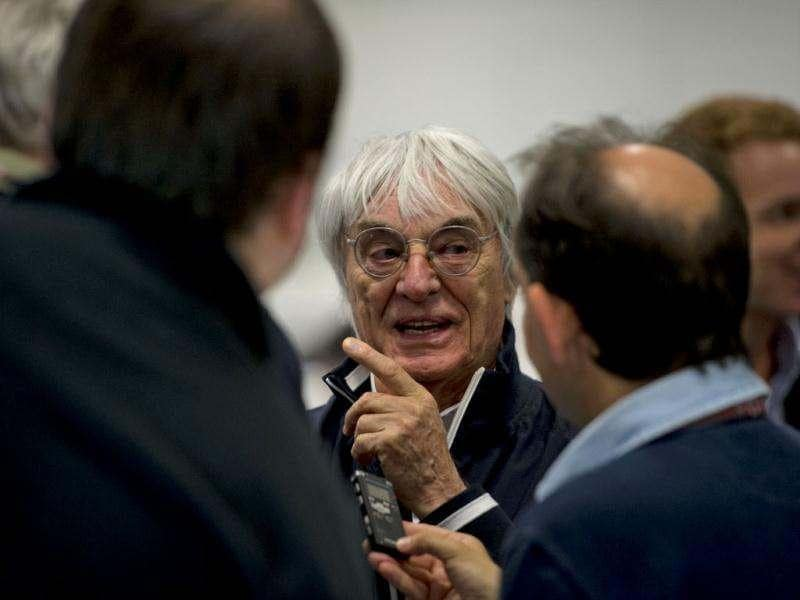 Formula One commercial director Bernie Ecclestone talks to journalists during a visit at the international press center at the Silverstone circuit ahead of the British Formula 1 Grand Prix. AP/Tom Hevezi