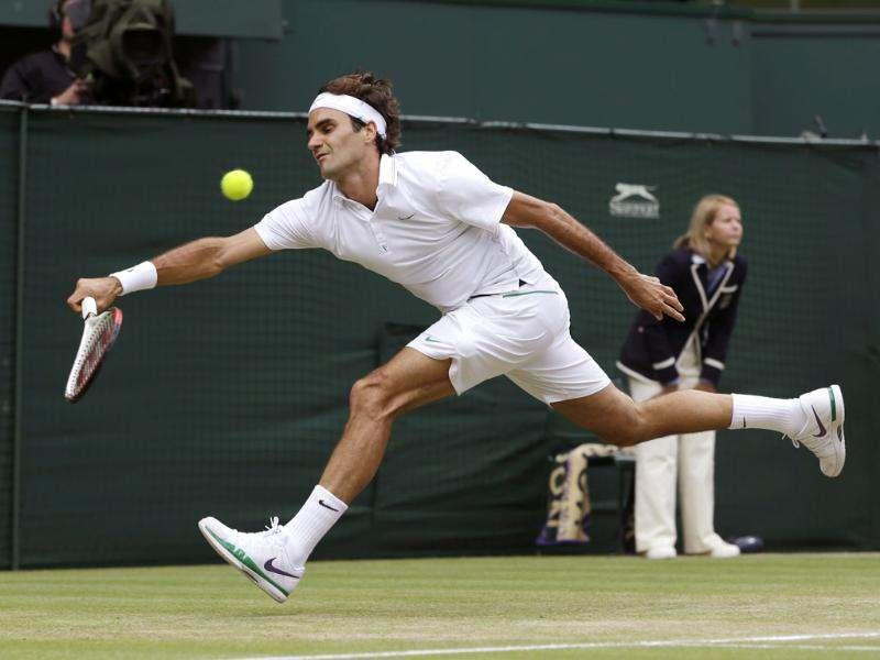 Roger Federer of Switzerland plays a shot to Andy Murray of Britain during the men's final match at the All England Lawn Tennis Championships at Wimbledon, England. AP/Kirsty Wigglesworth