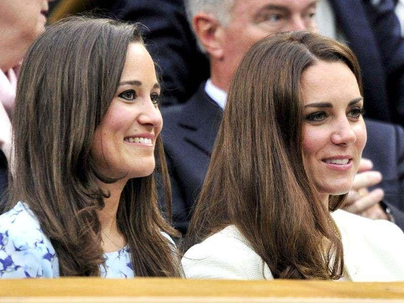 Britain's Catherine, Duchess of Cambridge sits with her sister Pippa Middleton on Centre Court for the men's singles final tennis match between Roger Federer of Switzerland and Andy Murray of Britain at the Wimbledon Tennis Championships in London. Reuters/Toby Melville
