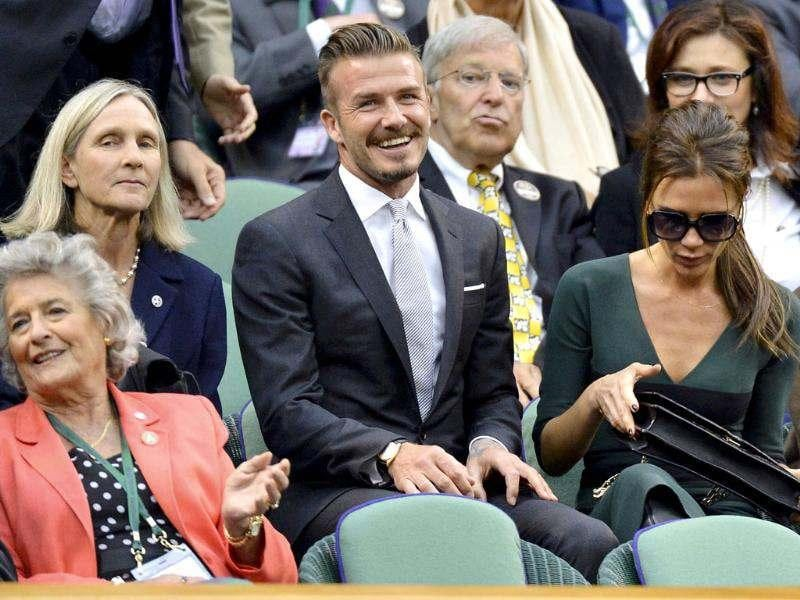 British soccer player David Beckham sits with his wife Victoria on Centre Court for the men's singles final tennis match between Roger Federer of Switzerland and Andy Murray of Britain at the Wimbledon Tennis Championships in London. Reuters/Toby Melville