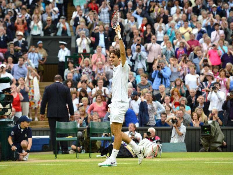 Switzerland's Roger Federer celebrates after his men's singles final victory over Britain's Andy Murray during Wimbledon Championships tennis tournament at the All England Tennis Club in Wimbledon, southwest London. AFP/Leon Neal