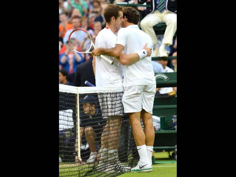 Switzerland's Roger Federer embraces Britain's Andy Murray after his men's singles final victory during Wimbledon Championships tennis tournament at the All England Tennis Club in Wimbledon, southwest London. AFP/Leon Neal