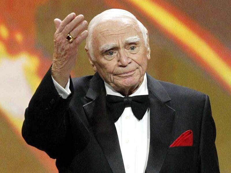 Ernest Borgnine waves after receiving his award at the 17th annual Screen Actors Guild Awards in Los Angeles, California in this file photo. US actor Borgnine, whose bulldog appearance made him a natural for tough-guy roles in films like The Wild Bunch but who won an Oscar for playing a sensitive loner in Marty, died at the age of 95. Reuters/Mario Anzuoni