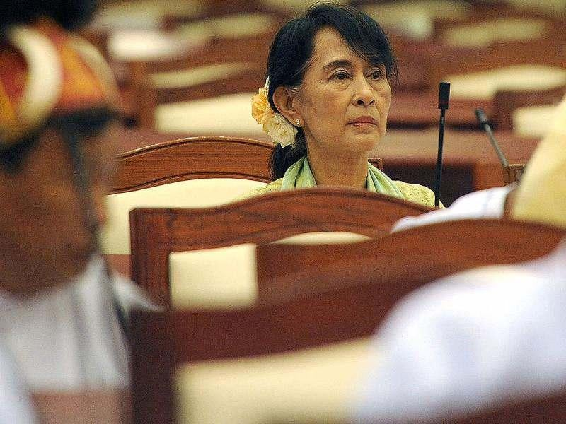 Myanmar opposition leader Aung San Suu Kyi (C) attends the lower house parliament session in Naypyidaw. Suu Kyi made her historic parliamentary debut, marking a new phase in her near quarter century struggle to bring democracy to her army-dominated homeland. AFP/Soe Than Win