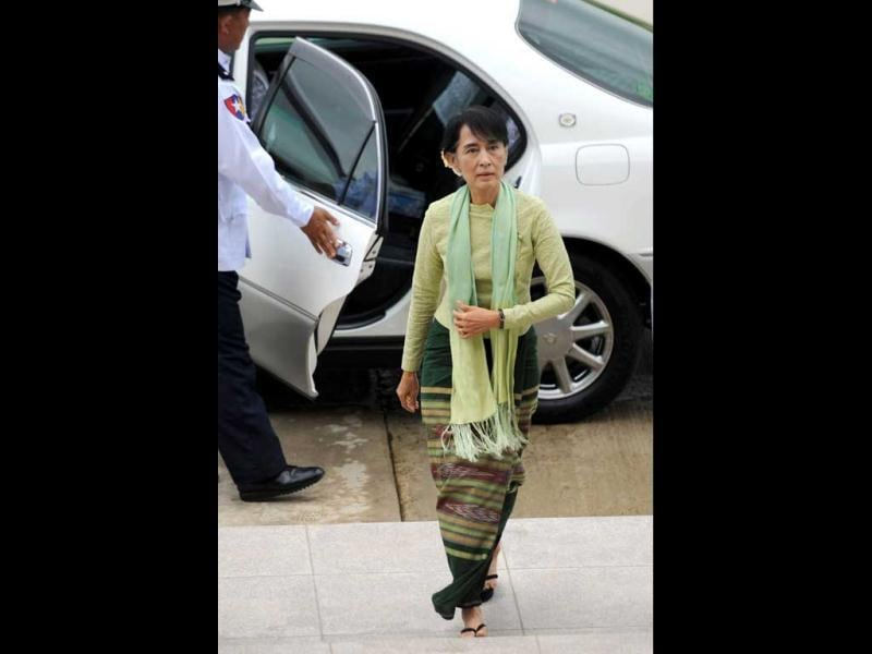 Myanmar opposition leader Aung San Suu Kyi (R) arrives at the Lower House Parliament building to attend a parliament session in Naypyidaw. Suu Kyi made her historic parliamentary debu, marking a new phase in her near quarter century struggle to bring democracy to her army-dominated homeland. AFP/Soe Than Win