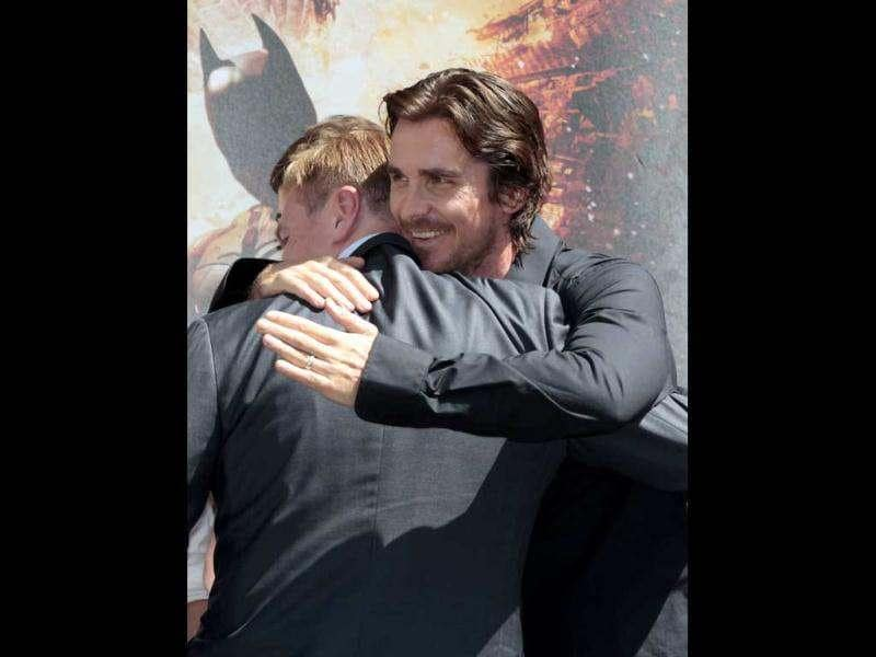 Actor Christian Bale (R) congratulates director Christopher Nolan at his hand and footprint ceremony in the forecourt of the Grauman's Chinese Theatre in Hollywood, California.