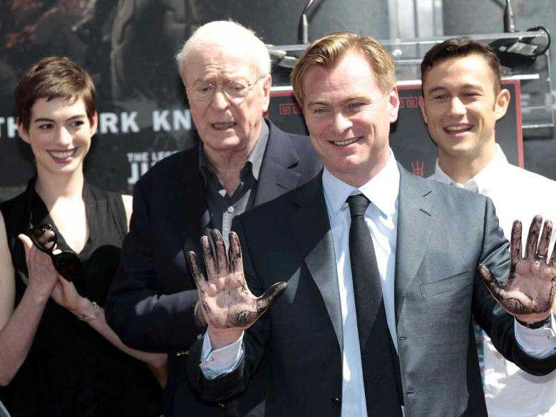 Director Christopher Nolan shows off his hands after leaving his handprints in cement during a hand and footprint ceremony in the forecourt of the Grauman's Chinese Theatre in Hollywood.