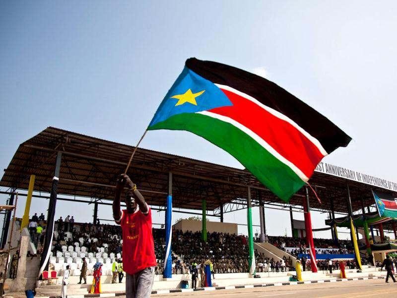 A man waves the national flag of South Sudan during celebrations to mark the country's first anniversary of its independence in Juba. Reuters Photo/Adriane Ohanesian