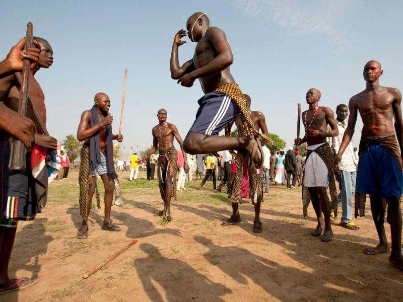 Southern Sudanese men dance in Juba to celebrate their country's first independence anniversary. AFP Photo/Giulio Petrocco