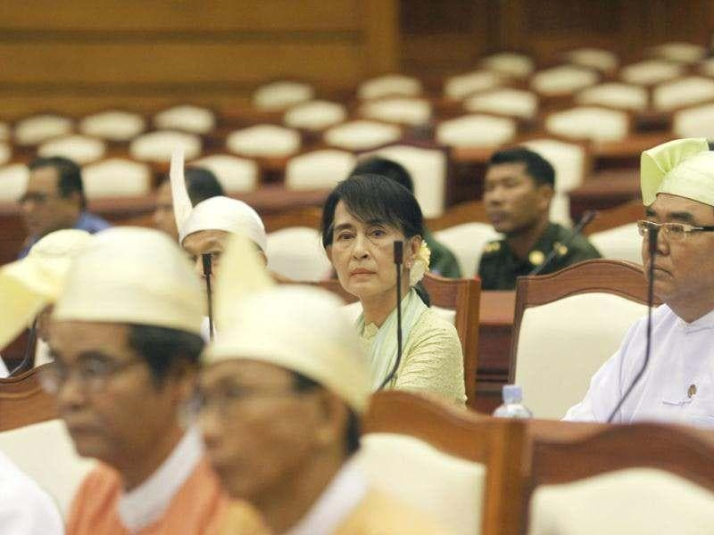 Myanmar pro-democracy leader Aung San Suu Kyi attends a parliamentary meeting at the Lower House of Parliament in Naypyitaw. (Reuters)
