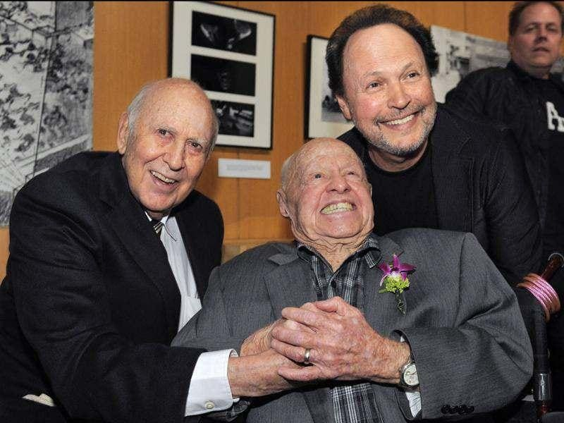 Moderator Billy Crystal, right, poses with It's A Mad, Mad, Mad, Mad World cast members Carl Reiner, left, and Mickey Rooney at the kick-off of The Last 70mm Film Festival presented by the Academy of Motion Picture Arts and Sciences, at the Samuel Goldwyn Theater in Beverly Hills, California. AP/Chris Pizzello