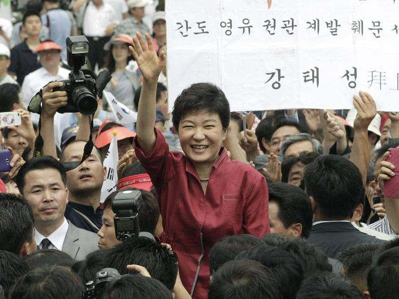Park Geun-hye, a former leader of the conservative ruling Saenuri Party, waves to her supporters during a ceremony to announce her plan to run for president in Seoul, South Korea. AP/Ahn Young-joon