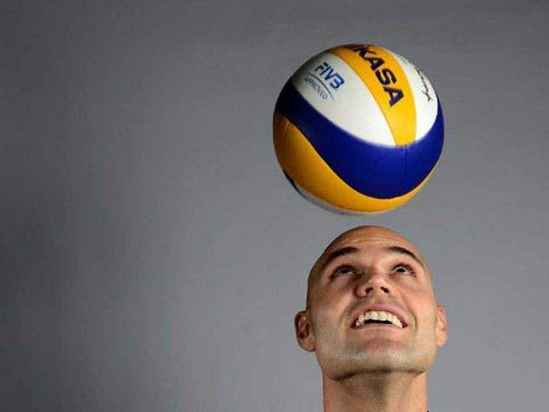Phil Dalhausser of the US Olympic Volleyball team poses for pictures during the 2012 Team USA Media Summit in Dallas, Texas. Portraits of the US Olympic team taken by AFP photographer Joe Klamar have been criticised for using awkward poses, wrong lens and lighting. Joe brushed off most of the criticism, saying that his