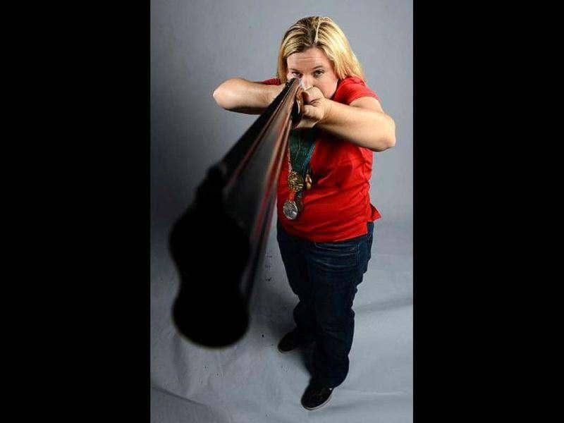 Kim Rhode of the US Shooting Olympic team poses for pictures during the 2012 Team USA Media Summit in Dallas, Texas. Portraits of the US Olympic team taken by AFP photographer Joe Klamar have been criticised for using awkward poses, wrong lens and lighting. Joe brushed off most of the criticism, saying that his
