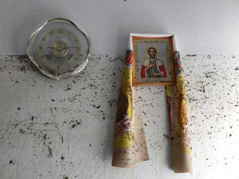 An icon hangs on the wall, with dirt from the floods marked on it, in the town of Krymsk in Krasnodar region, southern Russia. Reuters/Eduard Korniyenko
