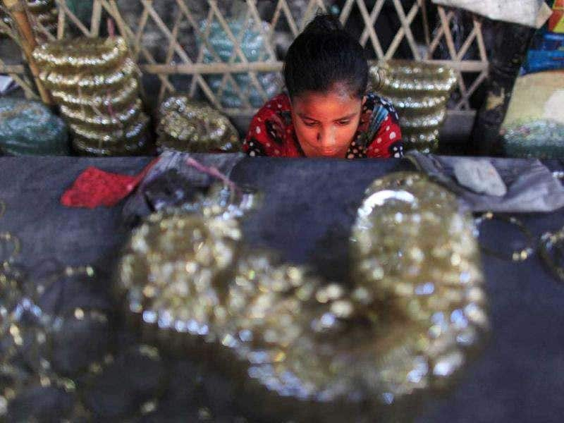 Dola, 12, works in front of a small kiln at a glass bangle factory in Old Dhaka. Reuters photo/Andrew Biraj
