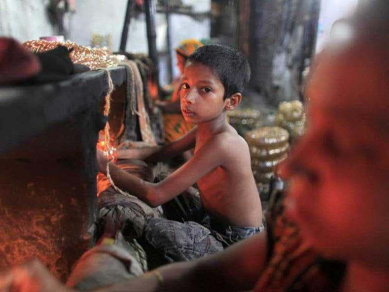 Hridoy, 7, works in front of a small kiln at a glass bangle factory in Old Dhaka. Reuters photo/Andrew Biraj