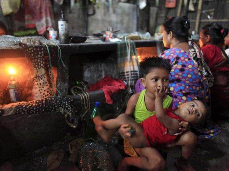 Workers' children play next to kilns at a glass bangle factory in Old Dhaka. Reuters photo/Andrew Biraj