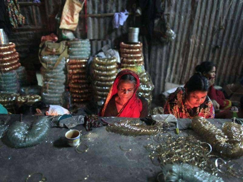 Labourers work in front of small kilns at a glass bangle factory in Old Dhaka. Reuters photo/Andrew Biraj