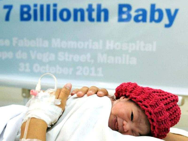 Danica Mae Camacho, the Philippine's symbolic 7 billionth baby is coddled by her mother Camille during a welcoming ceremony after she was born at a government-run maternity hospital in Manila on October 31, 2011. Africa and Asia will see the fastest urban population growth in the next 40 years, a UN report said earlier in the year noting that India and China are leading the surge. AFP/Ted Aljibe