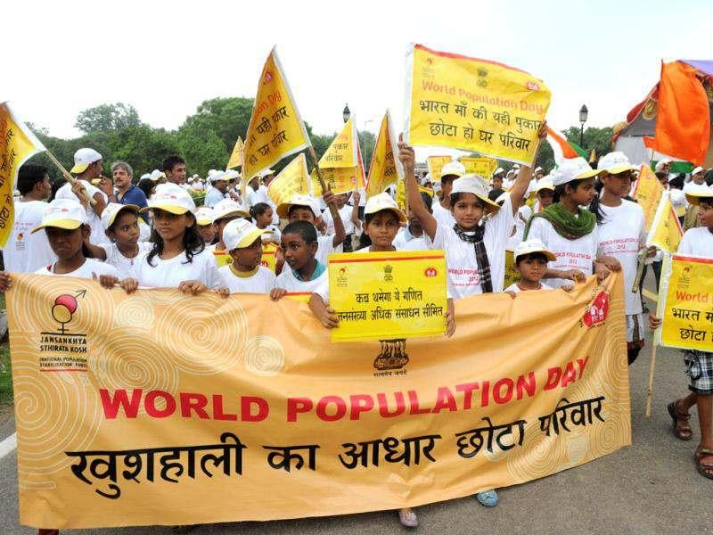 School children wave placards and banners as they take part in a rally held to mark World Population Day at India Gate in New Delhi. Africa and Asia will see the fastest urban population growth in the next 40 years, a UN report said earlier in the year noting that India and China are leading the surge. AFP/Sajjad Hussain