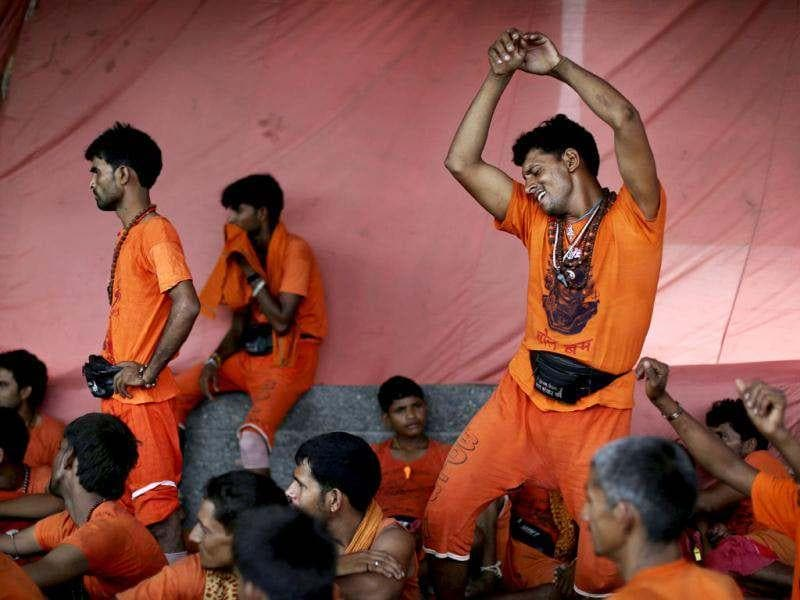 Kanwarias, worshippers of God Shiva, dance to devotional songs in New Delhi. AP Photo/Kevin Frayer