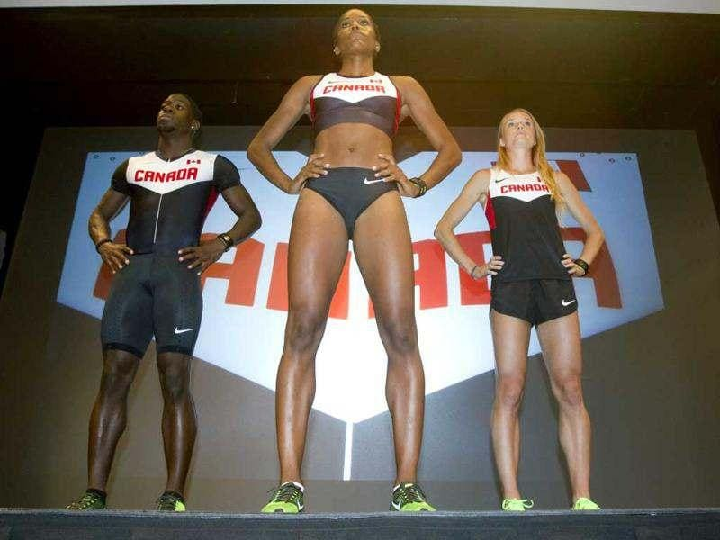 Canadian Olympic athletes Phylicia George (C), Justyn Warner (L) and Sarah Wells wear the competition apparel they will be clothed in during the coming summer Olympics at a press conference held by Nike and Athletics Canada in Toronto. (Reuters/Fred Thornhill)
