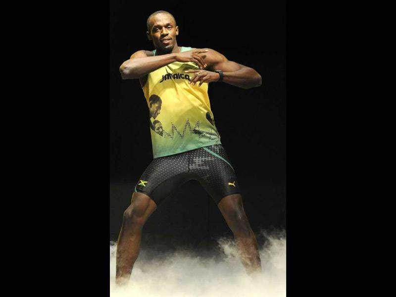 Jamaican sprinter Usain Bolt models the Jamaican team's kit for the London 2012 Olympic Games, designed by Cedella Marley, at a fashion show in London. (Reuters/Paul Hackett)