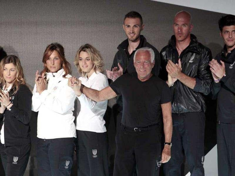 Italian designer Giorgio Armani acknowledges applause with Italian athletes who will participate in the London 2012 Olympic Games during the presentation of the Italy's official Olympic kit in Milan. (Reuters/ Stefano Rellandini)