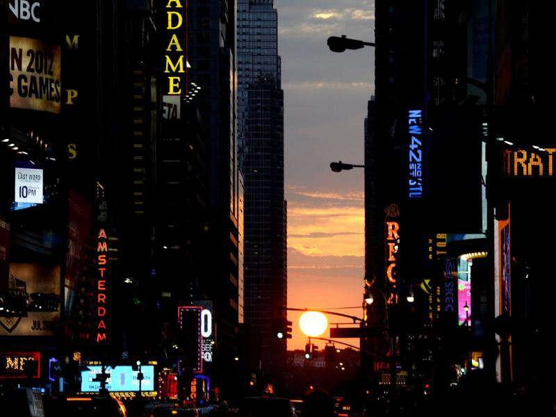The sun sets as seen from 42nd street in New York City, as Manhattanhenge, sometimes also referred to as Manhattan Solstice, the biannual natural event, when it is perfectly aligned with Manhattan's numbered streets. AFP PHOTO / TIMOTHY A. CLARY