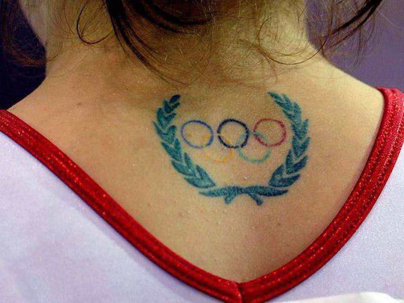 Nathalia Sanchez of Colombia is seen with a tattoo of the Olympic rings on her neck during the Women's Artistic Gymnastics Finals in Guadalajara, Mexico.