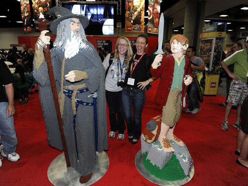 Fans pose with life-sized LEGO Lord of the Rings figures at Comic Con preview night held at the San Diego Convention Center in San Diego. AP/Denis Poroy