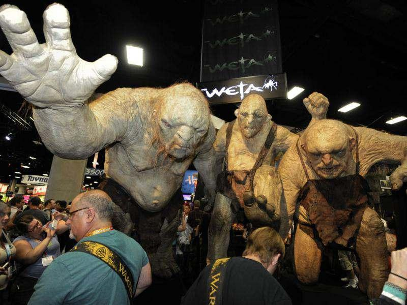 Fans walk past huge Stone Troll figures from the Lord of the Rings at the Comic Con preview night held at the San Diego Convention Center in San Diego. AP/Denis Poroy