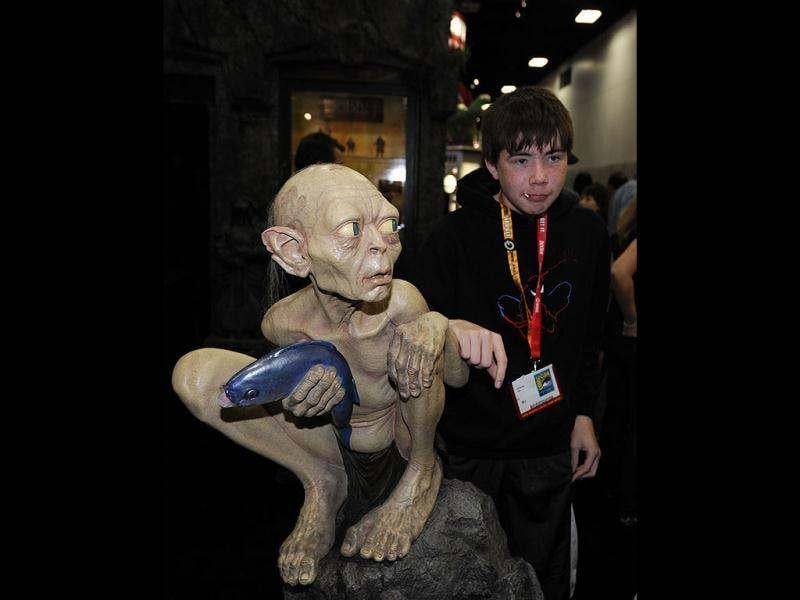 Christian Ash poses with a Gollum figure from the Lord of the Rings at the Comic Con preview night held at the San Diego Convention Center in San Diego. AP/Denis Poroy