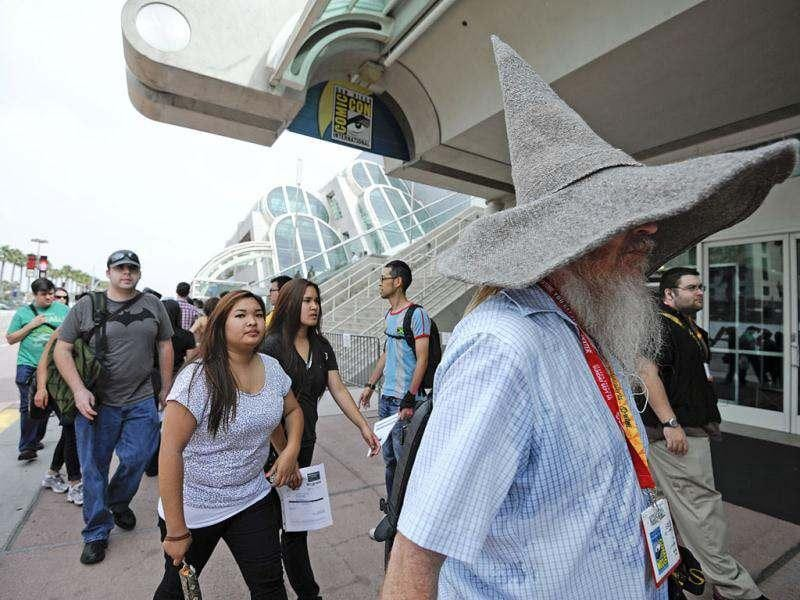 Fans arrive at the San Diego Convention Center before preview night at Comic Con in San Diego. AP/Denis Poroy