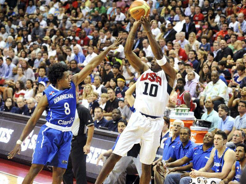 In this photo provided by the Las Vegas News Bureau, United States Olympic men's basketball team member Kobe Bryant (10) shoots a 3-pointer against the Dominican Republic during an exhibition game in Las Vegas. The US won 113-59. AP/Las Vegas News Bureau/Brian Jones