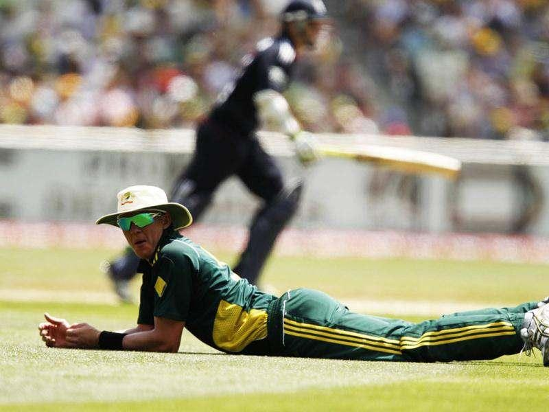 Australia's Brett Lee lies on the ground after attempting to field the ball as England's Andrew Strauss runs during their one-day international cricket match at the Melbourne Cricket Ground. Pace bowler Lee has announced his retirement from international cricket, Australian media reported on July 13, 2012. REUTERS