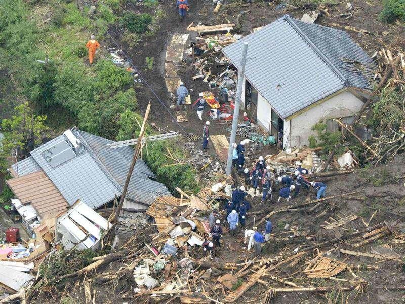 An aerial view shows firefighters searching among collapsed houses following a landslide caused by heavy rains in Minamiaso town, Kumamoto prefecture. Reuters
