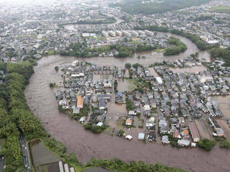 Residential streets are submerged after a river overflowed its banks in Kumamoto, Kumamoto prefecture on Japan's southern island of Kyushu. AP Photo/Yomiuri Shimbun