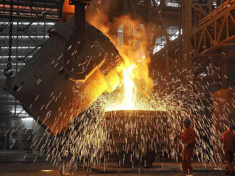Labourers work at a steel factory in Dalian, Liaoning province. China's economy grew 7.6% in the second quarter of 2012 from a year earlier, its slowest pace in three years. Reuters/China Daily