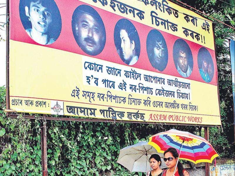 A hoarding showing the pictures of some of the accused who molested a teenager was put up in Guwahati on Friday. The caption said they have shamed the Assamese society. PTI photo