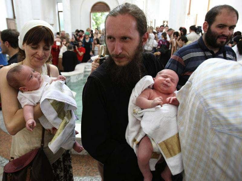 Babies are baptized during a mass baptism ceremony in the Holy Trinity Cathedral in Tbilisi, Georgia. (AP Photo/Shakh Aivazov)